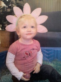 My daughter, Evelyn, wearing a flower hat at her Brownsburg day care