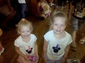 Elaina & Evelyn at Disney World, waiting for the Country Bear Jamboree show to begin